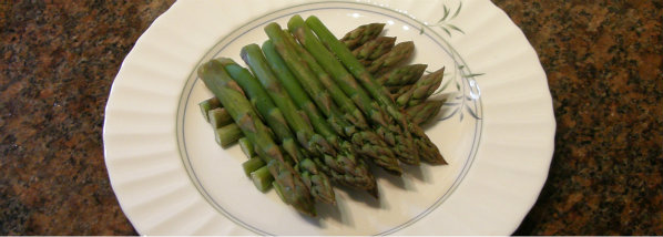 Bed of asparagus ready for topping with poached egg