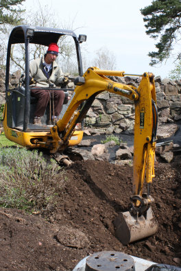 Digging an asparagus bed in style with a mini digger!