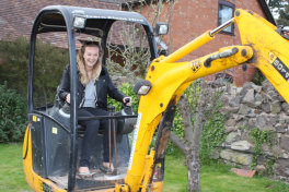 Emma drives the digger