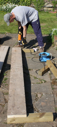 Making an asparagus raised bed from old planks