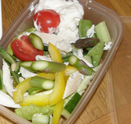 Lunch box contains chopped veg including Asparagus